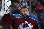 Colorado Avalanche goaltender Semyon Varlamov adjusts his glove during a time out against the Vegas Golden Knights in the second period of an NHL hockey game Monday, Feb. 18, 2019, in Denver. (AP Photo/David Zalubowski)