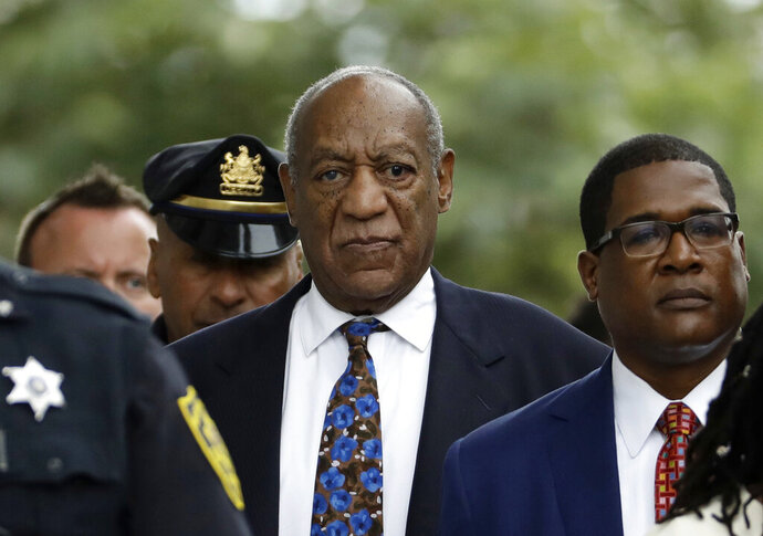 FILE - In this Sept. 24, 2018, file photo, Bill Cosby departs after a sentencing hearing at the Montgomery County Courthouse in Norristown, Pa. Legal advocates are lining up on both sides of actor Bill Cosby's appeal as the Pennsylvania Supreme Court prepares to review his 2018 sex assault conviction. (AP Photo/Matt Slocum, File)
