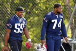 New England Patriots linebacker Terez Hall (59) and linebacker Anfernee Jennings (74) walk onto the field during an NFL football training camp practice, Friday, Aug. 21, 2020, in Foxborough, Mass. (AP Photo/Michael Dwyer, Pool)