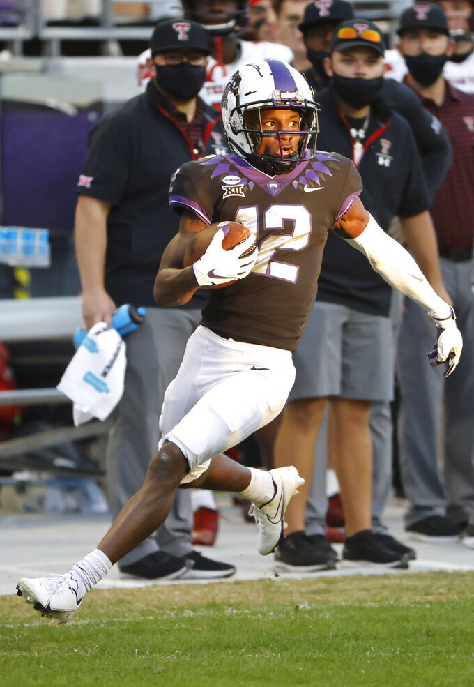 TCU wide receiver Derius Davis (12) returns a punt to the Texas Tech 14 yard line during the second half of an NCAA college football game Saturday, Nov. 7, 2020, in Fort Worth, Texas. TCU won 34-18. (AP Photo/Ron Jenkins)