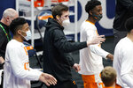 Injured Tennessee forward John Fulkerson, center, cheers on his teammates in the first half of an NCAA college basketball game against Alabama in the Southeastern Conference Tournament Saturday, March 13, 2021, in Nashville, Tenn. (AP Photo/Mark Humphrey)
