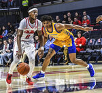 Mississippi guard Devontae Shuler (2) drives past Cal State Bakersfield guard Justin McCall (22)  during an NCAA college basketball game, Saturday, Dec, 7, 2019, in Oxford, Miss. (Bruce Newman/The Oxford Eagle via AP)