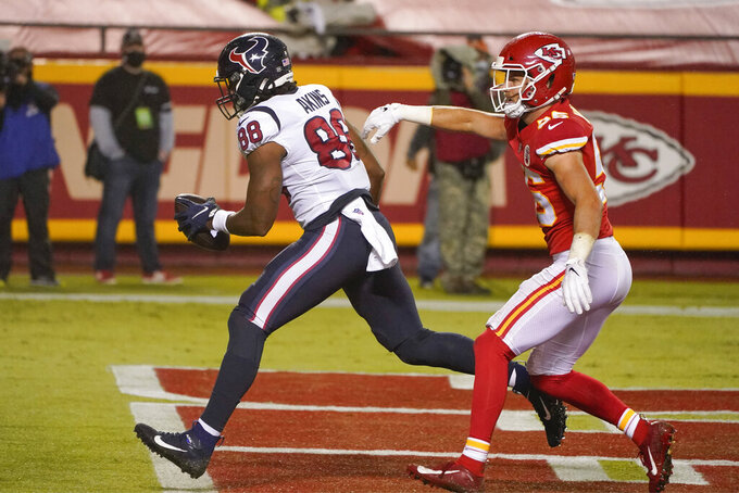 Houston Texans tight end Jordan Akins (88) scores a touchdown ahead of Kansas City Chiefs linebacker Ben Niemann (56) in the second half of an NFL football game Thursday, Sept. 10, 2020, in Kansas City, Mo. (AP Photo/Charlie Riedel)