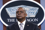 FILE - Secretary of Defense Lloyd Austin listens to a question as he speaks during a media briefing at the Pentagon in Washington, in this Friday, Feb. 19, 2021, file photo. U.S. Defense Secretary Lloyd Austin met Sunday, April 11, 2021, in Tel Aviv with his Israeli counterpart and reinforced American support. (AP Photo/Alex Brandon, File)