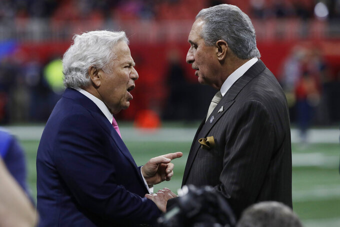 New England Patriots owner Robert Kraft, left, and Atlanta Falcons owner Arthur Blank, speak on the field, before the NFL Super Bowl 53 football game between the Los Angeles Rams and the New England Patriots Sunday, Feb. 3, 2019, in Atlanta. (AP Photo/Matt Rourke)