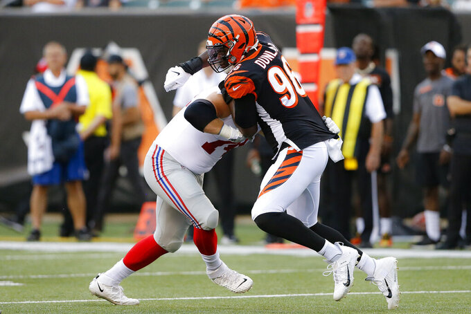 Cincinnati Bengals defensive end Carlos Dunlap (96) works against New York Giants offensive tackle Mike Remmers during the first half of an NFL preseason football game Thursday, Aug. 22, 2019, in Cincinnati. (AP Photo/Gary Landers)