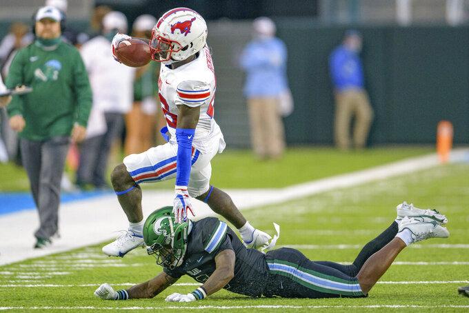 SMU running back Ulysses Bentley IV (26) runs against Tulane cornerback Jaylon Monroe (9) during an NCAA college football game in New Orleans, Friday, Oct. 16, 2020. (AP Photo/Matthew Hinton)