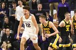 Northwestern forward Pete Nance (22) reacts after dunking next to Iowa guard Joe Wieskamp (10) during the first half of an NCAA college basketball game Tuesday, Jan. 14, 2020, in Evanston, Ill. (AP Photo/David Banks)