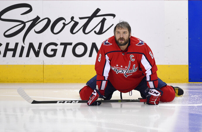 Washington Capitals left wing Alex Ovechkin (8), of Russia, stretches during warm ups before Game 3 of the NHL Eastern Conference finals hockey playoff series against the Tampa Bay Lightning, Tuesday, May 15, 2018 in Washington. (AP Photo/Nick Wass)