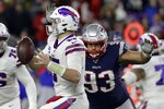 New England Patriots defensive tackle Lawrence Guy, right, closes in to sack Buffalo Bills quarterback Josh Allen in the second half of an NFL football game, Saturday, Dec. 21, 2019, in Foxborough, Mass. (AP Photo/Elise Amendola)