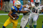 Miami Dolphins defensive back Nik Needham (40) sacks Los Angeles Chargers quarterback Justin Herbert (10), during the first half of an NFL football game, Sunday, Nov. 15, 2020, in Miami Gardens, Fla. (AP Photo/Wilfredo Lee)