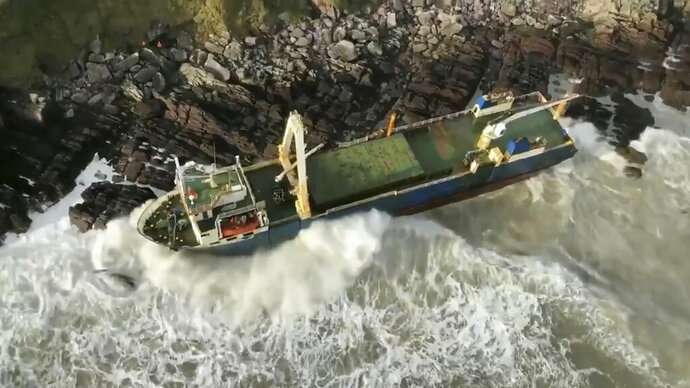 Undated image released Monday Feb. 17, 2020, by Irish Coast Guard showing an abandoned cargo ship the MV Alta, that has washed up on the coast of County Cork, near Ballycotton, southern Ireland.  The MV Alta is believed to have had 10 crew members aboard who were rescued by the US Coast Guard.  Since September 2018, the ship has been drifting with no crew aboard, and it was last seen off the coast of West Africa before being washed up in southern Ireland during Storm Dennis. (Irish Coast Guard via AP)