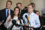Rep. Elise Stefanik, R-N.Y., front left, Rep. Jim Jordan, R-Ohio, right, and other Republican members of the House Intelligence Committee, speak to members of the media as they conclude the testimony of U.S. Ambassador to the European Union Gordon Sondland, during a public impeachment hearing of President Donald Trump's efforts to tie U.S. aid for Ukraine to investigations of his political opponents on Capitol Hill in Washington, Wednesday, Nov. 20, 2019. (AP Photo/Manuel Balce Ceneta)