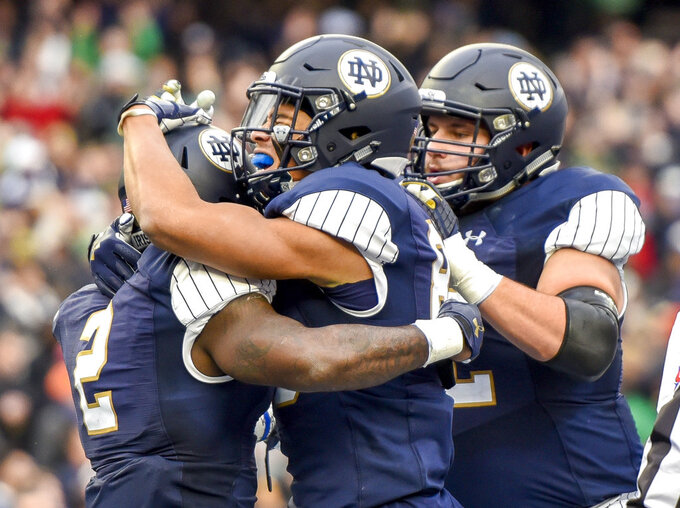 Notre Dame running back Dexter Williams (2) celebrates  with teammates after scoring in the first half of an NCAA college football game against Syracuse, Saturday, Nov. 14, 2018, at Yankee Stadium in New York. (AP Photo/Howard Simmons)