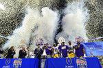 LSU coach Ed Orgeron and team celebrate winning the Peach Bowl NCAA semifinal college football playoff game against Oklahoma, Saturday, Dec. 28, 2019, in Atlanta. LSU won 63-28. (AP Photo/John Amis)