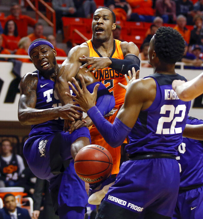 From left, TCU's JD Miller (15), Oklahoma State's Cameron McGriff (12) and TCU's RJ Nembhard (22) battle for a rebound in the first half of a NCAA college basketball game in Stillwater, Okla., Monday, Feb. 18, 2019. (Nate Billings/The Oklahoman via AP)
