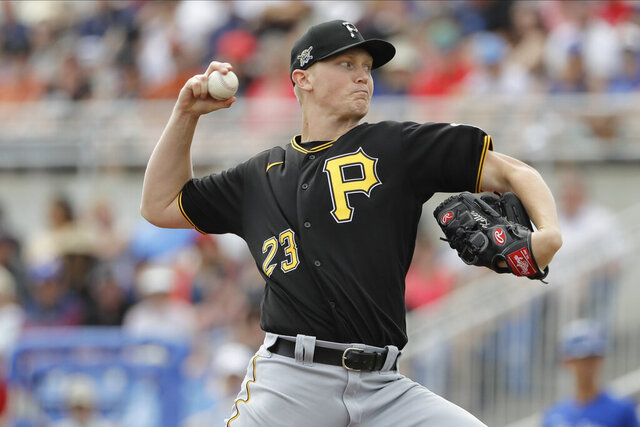 Pittsburgh Pirates' Mitch Keller (23) delivers a pitch during the first inning of a spring training baseball game against the Toronto Blue Jays Monday, March 2, 2020, in Dunedin, Fla. (AP Photo/Frank Franklin II)