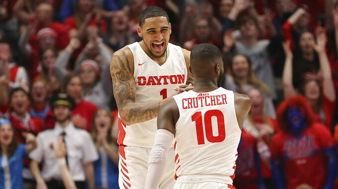 Dayton's Obi Toppin (1) and Jalen Crutcher (10) celebrate during the second half of an NCAA college basketball game against George Washington, Saturday, March 7, 2020, in Dayton, Ohio. (AP Photo/Tony Tribble)