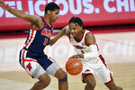 Arkansas guard JD Notae (1) tries to get past Mississippi defender Matthew Murrell (11) during the first half of an NCAA college basketball game Wednesday, Jan. 27, 2021, in Fayetteville, Ark. (AP Photo/Michael Woods)