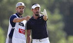 Mike Lorenzo-Vera, of France, talks to his caddie on the 3rd hole during the second round of the DP World Tour Championship golf tournament in Dubai, United Arab Emirates, Friday, Nov. 22, 2019. (AP Photo/Kamran Jebreili)