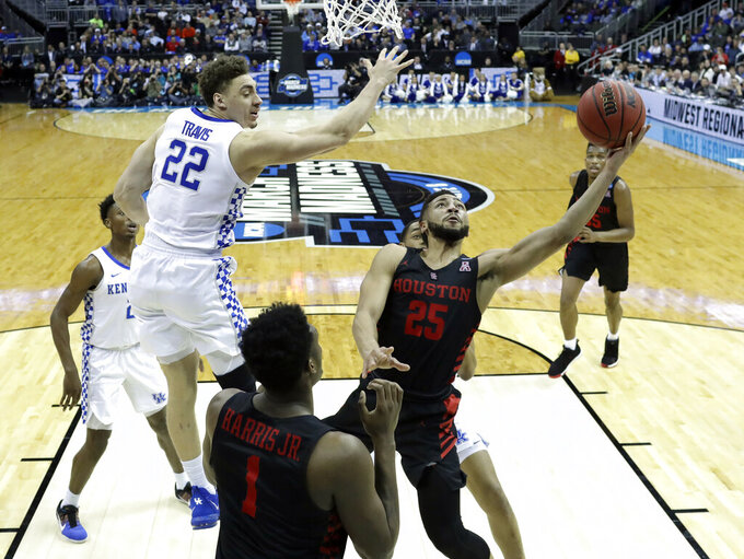 Houston's Galen Robinson Jr. (25) shoots as Kentucky's Reid Travis (22) defend during the second half of a men's NCAA tournament college basketball Midwest Regional semifinal game Friday, March 29, 2019, in Kansas City, Mo. (AP Photo/Orlin Wagner)