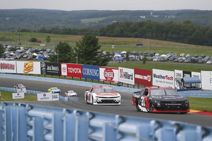 Erik Jones (31) and Brandon Brown (68) drive through the Esses in the NASCAR Xfinity Series auto race at Watkins Glen International in Watkins Glen, N.Y., on Saturday, Aug. 7, 2021. (AP Photo/Joshua Bessex)