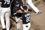 Chicago White Sox manager Tony La Russa, left, greets Danny Mendick after the team's 3-0 win over the Tampa Bay Rays in a baseball game Tuesday, June 15, 2021, in Chicago. (AP Photo/Charles Rex Arbogast)