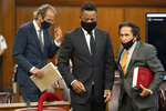 Actor Cuba Gooding Jr., center, approaches the defense table with his lawyer Marc Heller, right, during a hearing in his sexual misconduct case, Thursday, Aug. 13, 2020, in New York. A judge ordered the courtroom outfitted with Plexiglas and other measures to prevent the spread of the coronavirus, which has delayed the trial indefinitely.  (Steven Hirsch/New York Post via AP, Pool)