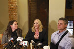 Tiffany Van Dyke, wife of a white Chicago police officer who fatally shot black teenager Laquan McDonald speaks during a news conference Thursday, Feb. 14, 2019, in Chicago as her attorneys Tammy Wendt, left, and Dan Herbert listen. Van Dyke says her husband has been assaulted by inmates in his Connecticut prison cell. Van Dyke was jailed in Rock Island, Illinois, before the move this month to the low-security prison in Danbury, Connecticut. (AP Photo/Teresa Crawford)