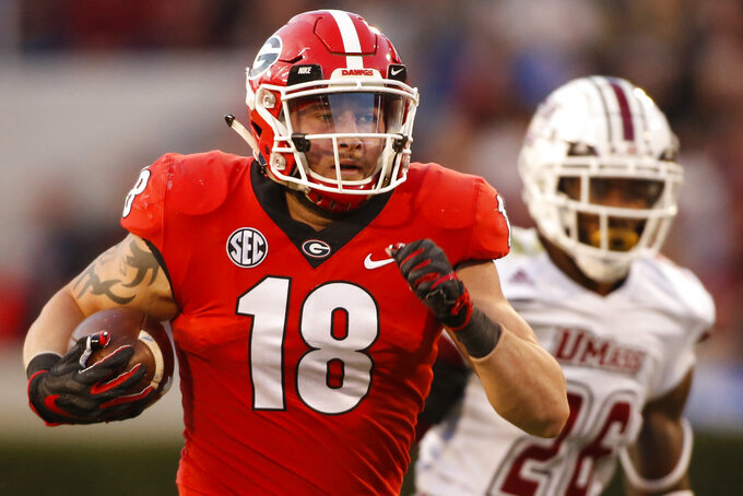 Georgia tight end Isaac Nauta (18) moves the ball down the field during the first half of an NCAA college football game against Massachusetts, Saturday, Nov. 17, 2018, in Athens, Ga. (Joshua L. Jones/Athens Banner-Herald via AP)