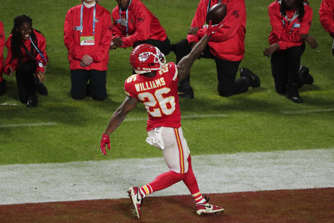 Kansas City Chiefs' Damien Williams (26) scores a touchdown, during the second half of the NFL Super Bowl 54 football game against the San Francisco 49ers, Sunday, Feb. 2, 2020, in Miami Gardens, Fla. (AP Photo/Charlie Riedel)