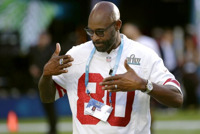 Former San Francisco 49ers wide receiver Jerry Rice walks on the field before the NFL Super Bowl 54 football game between the 49ers and Kansas City Chiefs Sunday, Feb. 2, 2020, in Miami Gardens, Fla. (AP Photo/Matt York)