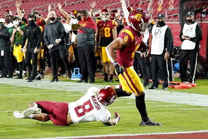 Southern California wide receiver Amon-Ra St. Brown, right, runs past Washington State defensive back Armani Marsh to score during the first half of an NCAA college football game in Los Angeles, Sunday, Dec. 6, 2020. (AP Photo/Alex Gallardo)