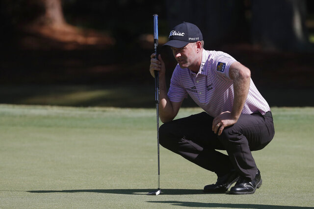 Webb Simpson lines up his putt on the first green, during the second round of the RBC Heritage golf tournament, Friday, June 19, 2020, in Hilton Head Island, S.C. (AP Photo/Gerry Broome)