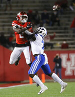 Houston safety Deontay Anderson (2) is interfered by BYU defensive back George Udo (7) during the third quarter of an NCAA college football game Friday, Oct. 16, 2020, in Houston. (Yi-Chin Lee/Houston Chronicle via AP)