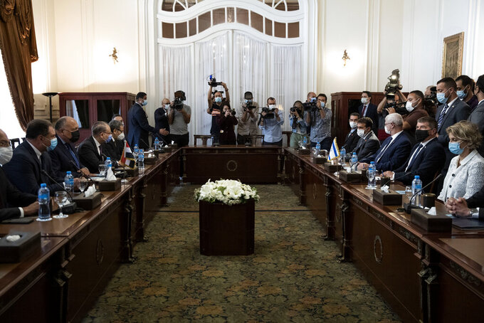 Egyptian Foreign Minister Sameh Shoukry, third from left, meets with Israeli Foreign Minister Gabi Ashkenazi, second  from wldright, at the Tahrir Palace in Cairo, Egypt, Sunday, May 30, 2021. (AP Photo/Nariman El-Mofty)