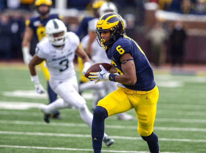 FILE - Michigan wide receiver Cornelius Johnson (6) rushes after making a catch to score a touchdown in the fourth quarter of an NCAA college football game against Michigan State in Ann Arbor, Mich., in this Saturday, Nov. 16, 2019, file photo. Johnson had 16 receptions for 254 yards and a team-high three touchdowns last year and has a shot to at least double his production in each category this season. (AP Photo/Tony Ding, File)