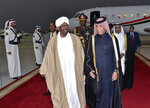 FILE - In this Tuesday, Jan. 22, 2019 handout file photo from Qatar News Agency, Sudanese President Omar al-Bashir, center left, is greeted at Hamad International Airport, Doha Qatar. As the uprising against Sudanese President Omar al-Bashir gained strength, Egypt, the United Arab Emirates and Saudi Arabia began reaching out to the military through secret channels to encourage his removal from power. They had long viewed al-Bashir as a problem because of his close ties to Islamists, and had grown weary of his shifting loyalties and outreach to their rivals, Turkey and Qatar. (Qatar News Agency via AP, File)