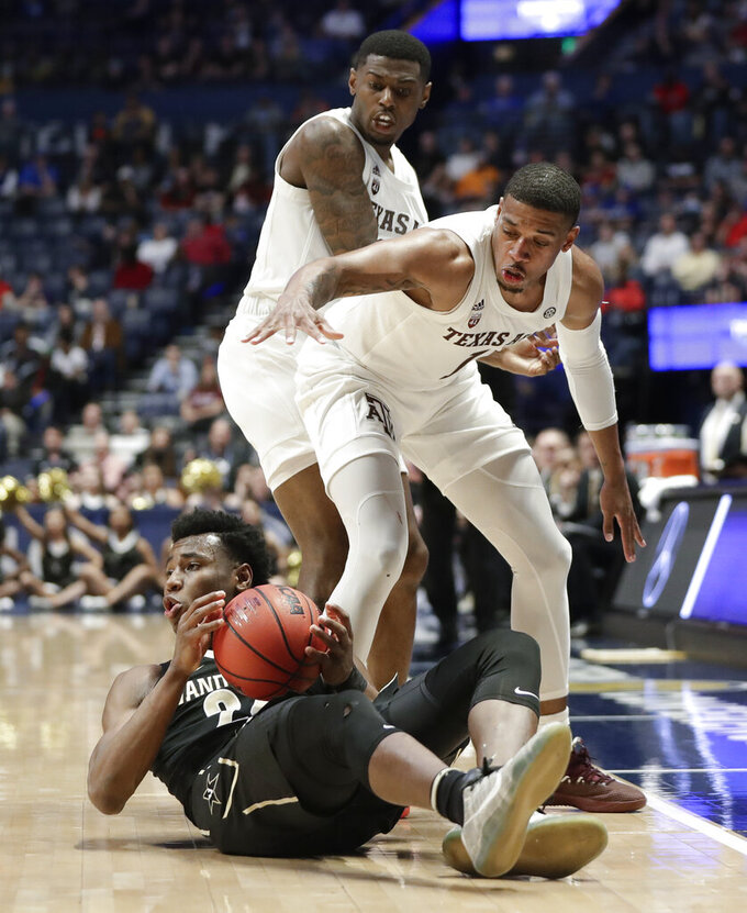 Vanderbilt forward Aaron Nesmith, bottom, looks for help as he is defended by Texas A&M's Savion Flagg (1) in the first half of an NCAA college basketball game at the Southeastern Conference tournament, Wednesday, March 13, 2019, in Nashville, Tenn. (AP Photo/Mark Humphrey)