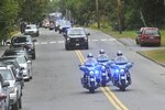 Maine State Police lead a procession honoring Farmington Fire Rescue Capt. Michael Bell as it arrives in Farmington, Maine, Tuesday, Sept. 17, 2019. Bell was killed in an explosion the day before that also injured six other firefighters and a maintenance worker at the LEAP building, a nonprofit that serves people with cognitive and intellectual disabilities in Farmington. (Rich Abrahamson/The Central Maine Morning Sentinel via AP)