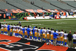 "The Los Angeles Chargers stand arm in arm as ""Lift Every Voice and Sing"" is played before an NFL football game between the Cincinnati Bengals and the Los Angeles Chargers, Sunday, Sept. 13, 2020, in Cincinnati. (AP Photo/Aaron Doster)"