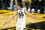 Iowa center Luka Garza celebrates after making a 3-point basket during the first half of an NCAA college basketball game against Nebraska, Thursday, March 4, 2021, in Iowa City, Iowa. (AP Photo/Charlie Neibergall)