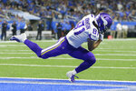 Minnesota Vikings wide receiver Olabisi Johnson (81) catches a 1-yard pass for a touchdown during the first half of an NFL football game against the Detroit Lions, Sunday, Oct. 20, 2019, in Detroit. (AP Photo/Duane Burleson)