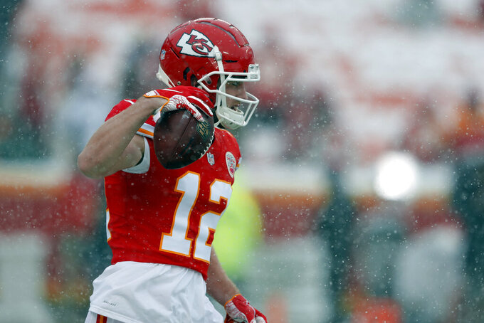 Kansas City Chiefs wide receiver Gehrig Dieter (12) warms up as snow falls before an NFL divisional football playoff game against the Indianapolis Colts in Kansas City, Mo., Saturday, Jan. 12, 2019. (AP Photo/Charlie Neibergall)