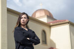 Sally Zakhari stands in front of the St. Mary & Archangel Michael Coptic Orthodox Church, Monday, Aug. 24, 2020, in Oviedo, Fla. Zakhari has alleged, including in a police report and to Coptic Church officials, that a Coptic priest visiting Florida in the late 1990s, Reweis Aziz Khalil, sexually abused her when she was 11 or 12. Khalil was stripped of his priesthood in July; he denied the allegations through his attorney. (AP Photo/Phelan M. Ebenhack)