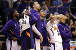 The Phoenix Suns react during the second half of an NBA basketball game against the Utah Jazz, Monday, Oct. 28, 2019, in Phoenix. The Jazz won 96-95. (AP Photo/Matt York)