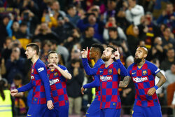 Barcelona's Lionel Messi, second right, celebrates after scoring his side's opening goal from the penalty spot during a Spanish La Liga soccer match between Barcelona and Real Sociedad at the Camp Nou stadium in Barcelona, Spain, Saturday, March 7, 2020. (AP Photo/Joan Monfort)