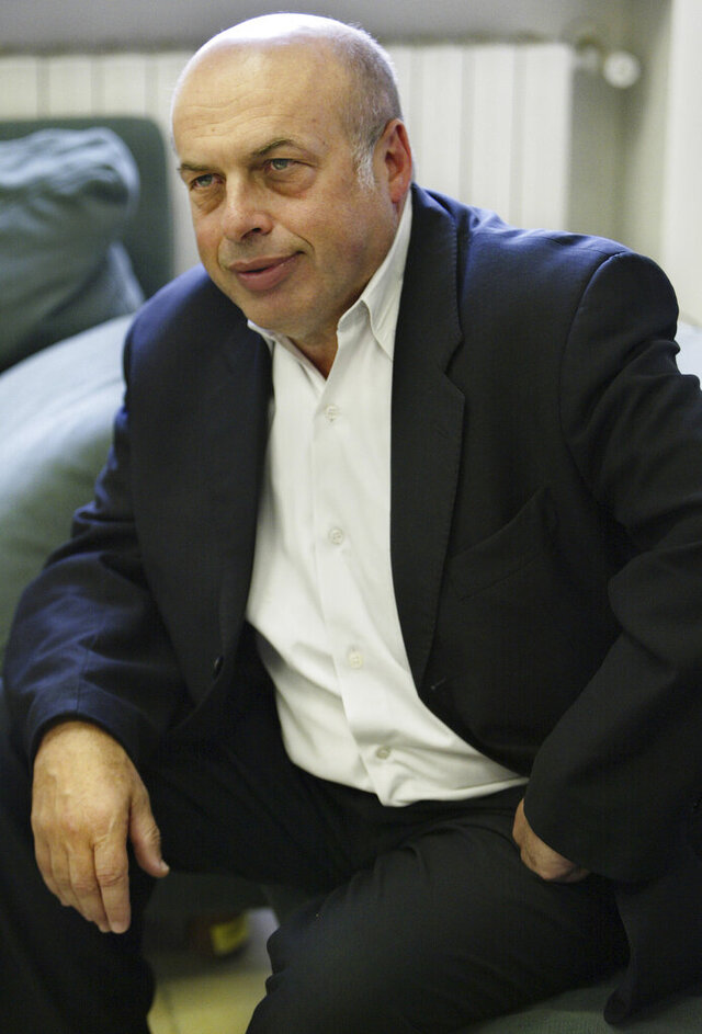 FILE - In this May 2, 2005 file photo, Natan Sharansky pauses during an interview with The Associated Press at his office in Jerusalem. The former Soviet dissident has been awarded Israel's prestigious Genesis Prize for a lifetime of work promoting political and religious freedoms, organizers announced Tuesday, Dec. 10, 2019. (AP Photo/Oded Balilty, File)