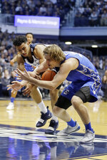 Butler's Jordan Tucker, left, and Creighton's Samson Froling vie for the ball during the first half of an NCAA college basketball game, Saturday, Jan. 5, 2019, in Indianapolis. (AP Photo/Darron Cummings)