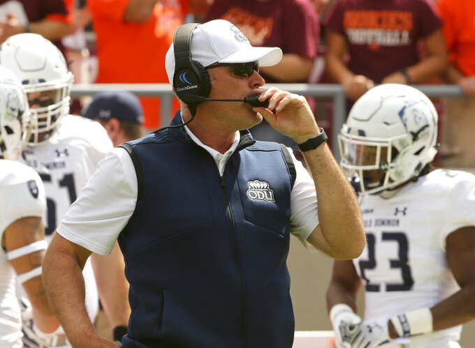 Old Dominion head coach Bobby Wilder at the start of the Virginia Tech - Old Dominion football game in Blacksburg Va. Saturday September 7 2019. (Matt Gentry/The Roanoke Times via AP)